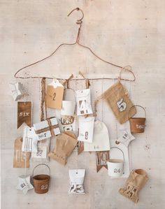 How-To: Getting the Hang of a New Advent Calendar by Vanessa Spencer @ Somerset Place, love the colorsheme of browns and white here and the idea of the hanging little gifts is so amazing, too!