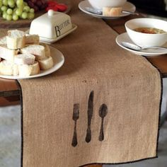Table Linens made of burlap type cloth and stenciled. Cute!