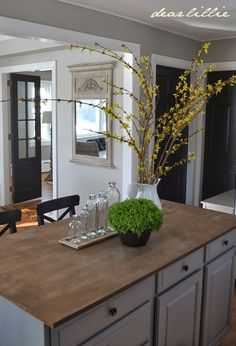 Wall Color - Revere Pewter by BM in a matte finish Trim - Simply White by BM in a semi-gloss finish Doors - Wrought Iron by BM in semi-glo...