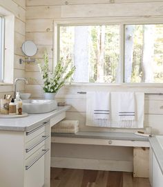 Wood-Paneled Bathroom - The homeowner of this Massachusetts cabin relied on Green Demolition for the guest bathroom's cabinets, as well as its Corian countertops. The striped-cotton Turkish towels are by Scents and Feel. Ideas Terraza, Baños Shabby Chic, Boho Chic, Guest Bathrooms, Bright Bathrooms, Chic Bathrooms, Small Bathroom, Neutral Bathroom, Bathroom Plants