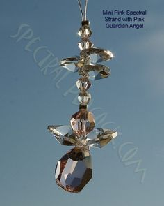 Mini Spectral Strand with Pink Guardian Angel - helps to reflect inner love and show you are a loving person www.crystalsuncatchers.co.uk www.wholesalecrystalsuncatchers.co.uk www.spectralpeacock.com