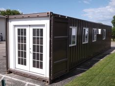 This is a prefab shipping container tiny home that's available for sale on Amazon through MODS International. It's a pre-fabricated tiny home based on a new shipping container with a be…