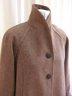 Shawl collar on raglan coat can be turned up for extra warmth.