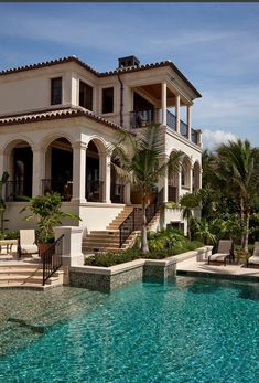 I would want this house because i like how there are palm trees around the pool and I like the structure.