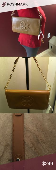 """🎄💯%Authentic Tory Burch Shoulder Clutch🎄🎄🎄🎄 All leather Bombe Reva Clutch that is so stunning🎄Carmel/ Burch rich color with a magnetic closure.Has 2 inside zipper compartments,with beautiful Tory Burch lugo in the front of the Clutch: approx 8""""Shoulder strap🎄 when the Clutch is opened, it measures 14"""" long Tory Burch Bags Shoulder Bags"""