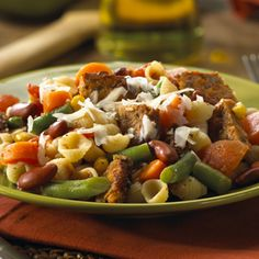 Italian seasoning and Parmesan cheese add flavor to this pasta, mixed vegetable and burger casserole.
