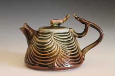 Desert Rose Teapot, Hand Carved Porcelain Teapot (Looks sort of creepy!)