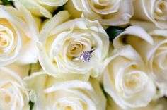 Gorgeous engagement ring position inside the bouquet, close up
