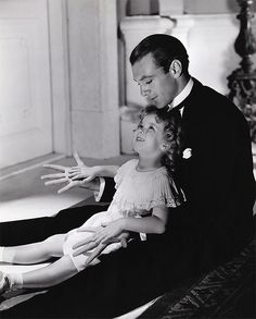 Gary Cooper & Shirley Temple, an unlikely pairing, inNow and Forever (1934). His romantic interest in the film was Carole Lombard.