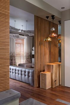 wood wall w built in seating, and wood slat room dividers.