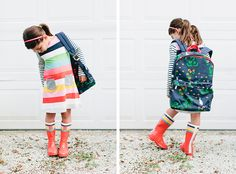 Well-ie hello there! Mommy Shorts' Mazzy in the Boden rainbow dress, red wellies and a cute print backpack, perfect for a fall school outfit.