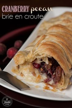 Warm Cranberry Pecan Brie en Croute wraps buttery puff pastry around brie, fresh cranberry sauce, and candied pecans to make the perfect holiday appetizer. {Self Proclaimed Foodie}