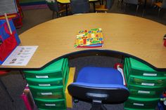 using bins under the guided reading table to keep things organized