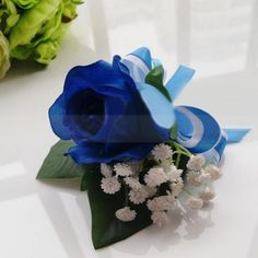 Intensive Blue Rose Wedding Corsage with Green Leaves and Two-Tone Ribbon