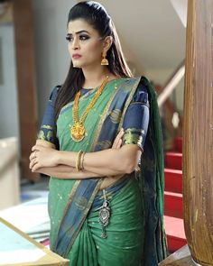 In a green color saree, puff high neck elbow length sleeve blouse design and hip key chain Beautiful Girl Indian, Beautiful Girl Image, Most Beautiful Indian Actress, Beautiful Saree, Sari Blouse Designs, Fancy Blouse Designs, Bollywood Designer Sarees, Saree Models, Indian Beauty Saree