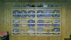 Handmade wall mounted plate racks.  Blue willow collection, hen on nest,  and red willow.
