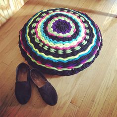 """Pinner says """"I made a moroccan style floor cushion (or poof) using two t-shirt hula hoop rugs that I wove! Awesome DIY"""""""