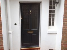 Kingston style timber doors in Warwick Stone colour with the frame in Cream. Features Brass hardware and Satinovo glass.