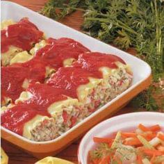 "Crab Lasagna Roll-Ups Recipe -With their creamy filling and delicate crab flavor, these roll-ups are simply satisfying. ""I serve this quick and easy dish at my cafe all the time,"" relates Fran Rodgers, Lake Geneva, Wisconsin. ""It's one of my favorites. Fish Recipes, Seafood Recipes, Pasta Recipes, Cooking Recipes, Lasagna Recipes, Surimi Recipes, Supper Recipes, Yummy Recipes, Recipies"