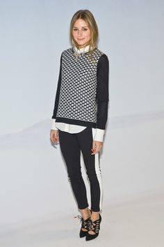 Backstage at Tibi, the style setter repped the brand with a printed Tibi sweater to top her Hudson jeans.