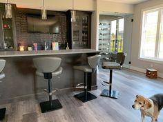 A nice space to unwind after a long day (doggo not included 🐶)! . We installed a luxury vinyl plank and backsplash tile to complete this bar look! . We offer free in home consultations if you need assistance in starting your renovation process! . . #yeghomedesign #yegflooring #yeghomes #yegrenovations #yegreno #yeglocalbusiness #yeglocal #yegcommunity Luxury Vinyl Plank, Backsplash Tile, House Design, Posts, Flooring, Bar, Space, Free, Furniture