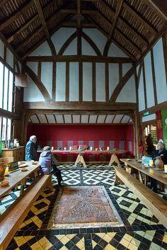 Barley Hall - the Great Hall, Set up for medieval dining, the hearth is the brick area centrally, the smoke exited through the tiles in the roof, the High Table for the master of the house at the end. The Jorvik Viking feast is held here in February, there are regular medieval banquets and it is a wedding venue