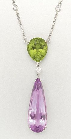 18K WHITE GOLD, KUNZITE, PERIDOT AND DIAMOND NECKLACE 1 kunzite, 1 peridot and 37 diamonds approx 20.55, 9.80 & 1.30 cts, length 16 ins.