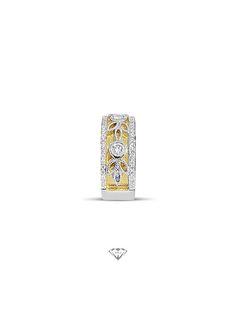 Handmade 9ct yellow and white gold diamond set engagement ring.