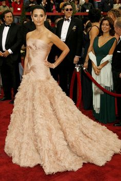 PENELOPE CRUZ  Penelope Cruz chose this blush feathered Versace gown to make an entrance to remember at the 2007 Academy Awards. The sheer extravagance of this creation makes it deservedly one of the most iconic dresses of all time. (2007)