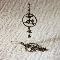 Birds of a Feather - Swarovski Crystal Antique Brass Bronze Love Bird Earrings - Neutral Fun Woodland Long Dangle Earrings by productsof47 on Etsy https://www.etsy.com/listing/110247317/birds-of-a-feather-swarovski-crystal