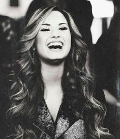 Demi Lovato even tho all the things she has gone through the pain and sadness (some similar to mine) she still can laugh...and if she can so can I!