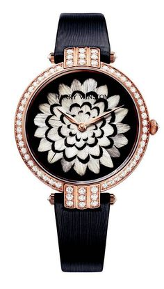 The Harry Winston Premier Ladies with a feather mosaic on the dial (choice of peacock or pheasant). It is set with 66 diamonds totaling 1.45 carats.
