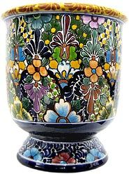 These extra-large Talavera planters feature wonderfully intricate floral patterns that will look great with your plants, indoors or out!  The ceramic of these Talavera planters is hand-painted in Dolores Hidalgo, Mexico, and embodies all the classic charm of Mexican Talavera.  Available in several shapes and sizes, all Talavera planters also feature a convenient drain hole.  Let the bright colors and your plants breathe life back into your home decor!