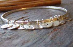 family charm............fine silver hand stamped initial bangle bracelet...could be a good grandmother's gift with initials of all the grandbabies