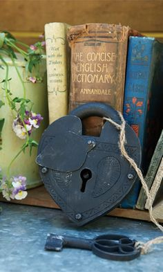 books and lock with key - I collect these old locks and keys for my son.who is now 25 and still enjoys receiving them. Old Door Knobs, Door Knobs And Knockers, Antique Keys, Vintage Keys, Vintage Books, Under Lock And Key, Key Lock, Old Keys, Key To My Heart