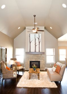 fireplace flanked by windows, vaulted ceiling, simple mantle ...