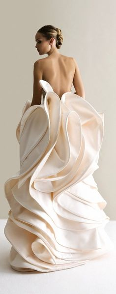 Who doesn't love the draping of this gown? It looks like frosting.