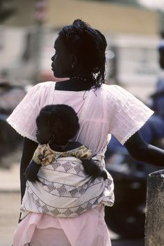 A mother and child in Dakar. 01 January 1984. Senegal. UN Photo/John Isaac