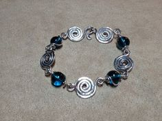 Womens spiral link, stirling silver bracelet, handmade, with spiral looped glass beads