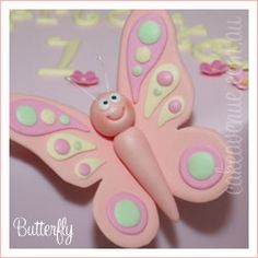 Cute butterfly cake topper.  http://www.cakeavenue.com.au/images/figurines/butterfly%2520peach.jpg
