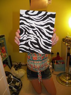 Zebra stripes. I took a small canvas and free handed a zebra pattern. Then just painted with black paint. This painting looks great in a zebra bedroom.