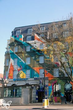 Members of the Agents of Change crew with London based Remi/Rough, Edinburgh's Steve More, LX.One from Paris, LA-based Augustine Kofie, and David Shillinglaw created what seems to be London's largest graffiti mural.