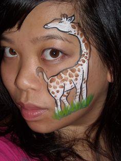 Half-face giraffe painting.