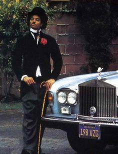 Michael Jackson dressed as his comedic hero Charlie Chapman.