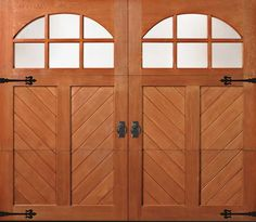 Clopay Reserve Collection custom wood carriage style garage door with Chevron pattern, arch windows and decorative hardware. Carriage Style Garage Doors, Wooden Garage Doors, Scandinavian Bedding, Craftsman Door, Laundry Room Remodel, Arched Windows, Cool House Designs, Custom Wood, Door Design