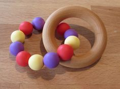 Wooden Silicone Teething Ring A beautiful natural & colourful teether that your baby will love! The wooden ring is made from natural Wooden Rings, Teething, Food Grade, Wax, Natural, Unique Jewelry, Handmade Gifts, Etsy, Beautiful