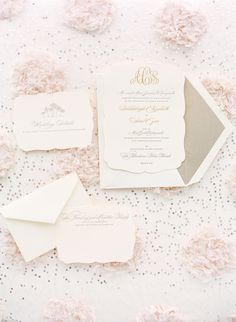 The wedding invitations featured an elegant design, in addition to the couple's wedding monogram in gold. #weddingstationery #weddinginvitation Photography: KT Merry Photography. Read More: http://www.insideweddings.com/weddings/soft-hued-spring-wedding-at-the-breakers-in-palm-beach-florida/581/