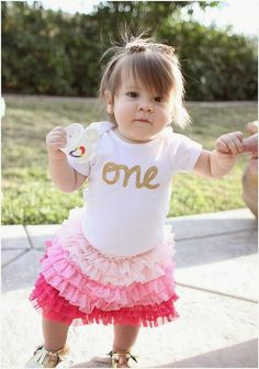 This listing is for a pure white, Carters brand bodysuit with one in cursive lettering across the front. This bodysuit is great for a first