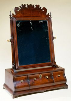 Queen Anne mahogany dressing mirror with bombe base  Boston, Massachusetts, circa 1760  Private collection