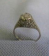 14 K White gold Fillagree Lady's Diamond ring with 7 diamonds size 7